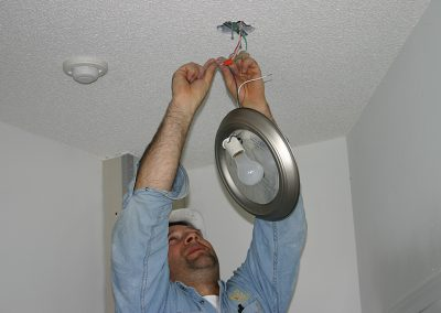 electrician connecting ceiling lighting