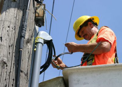 electrical worker connecting power lines