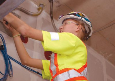 female electrician running wiring